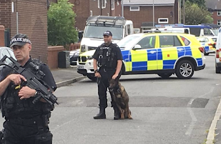Man, 19,Becomes The 15th Suspect To Be Arrested Over Manchester Terror Attack As Armed Police Swoop On THREE Areas Of The City In A Single Day