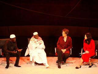 Abdoulie (far left) speaking on stage