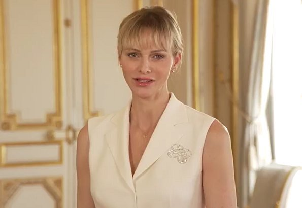 The South African branch of the Princess Charlene of Monaco Foundation. Brunello Cucinelli collection ivory sleeveless blazer
