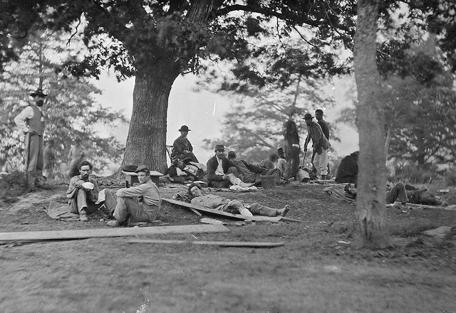 Wounded soldiers at rest near Marye's Heights, Fredericksburg, Virginia. After the battle of Spotsylvania, in 1864.