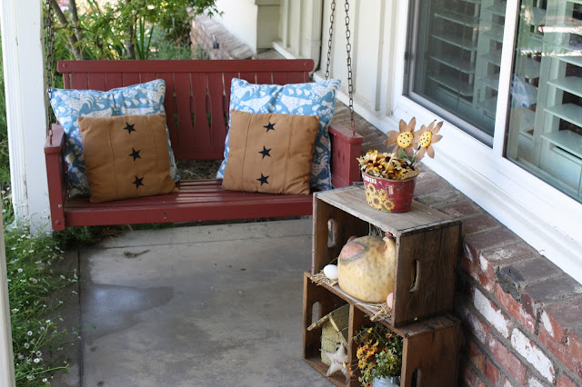 porch swing, pillows