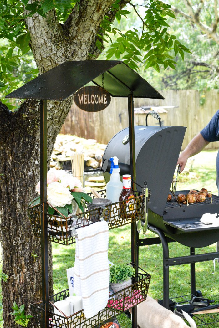 Genius idea! Use a plant stand as a grilling station to hold all the things you need for outdoor entertaining, grilling and dining. | via monicawantsit.com