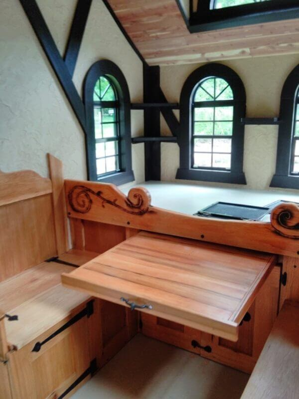 05-Sliding-Table-Dining-Room-Steve-Auth-Woolywagons-Tiny-House-The-Tudor-Cottage-Architecture