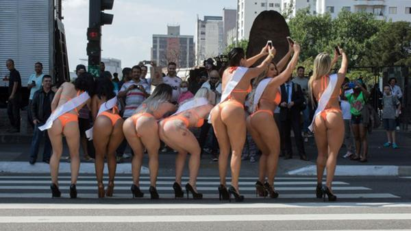 Participants of Miss Bum Bum played the Pokémon Go in the streets of São Paulo