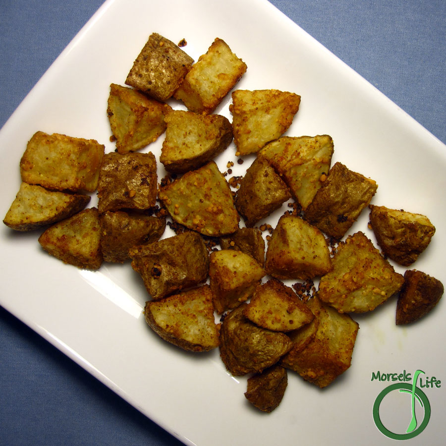 Morsels of Life - Parmesan Roasted Potatoes - Roasted potatoes with a crispy Parmesan, paprika, and garlic coating protecting a tender interior.