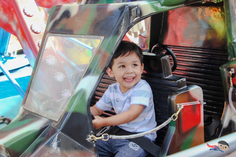 Baby Garrett riding Red Baron in Sky Ranch, Baguio