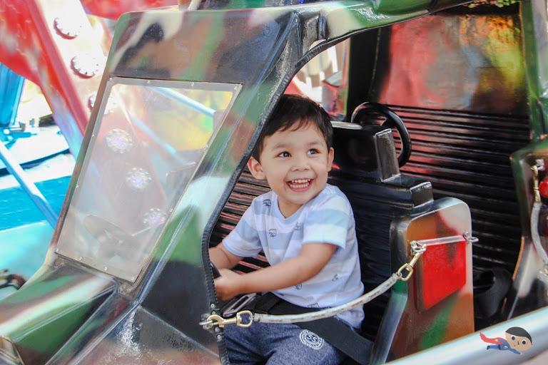 Baby Garrett riding Red Baron in Sky Ranch, Baguio