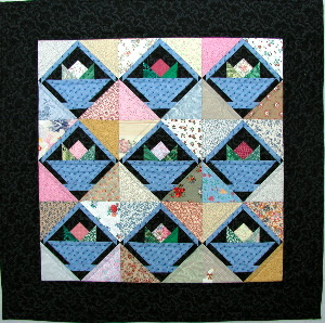 Quilt inspiration free pattern day basket quilts basket of flowers 385 x 365 free pattern by nanette holmberg for american quilter pdf download mightylinksfo