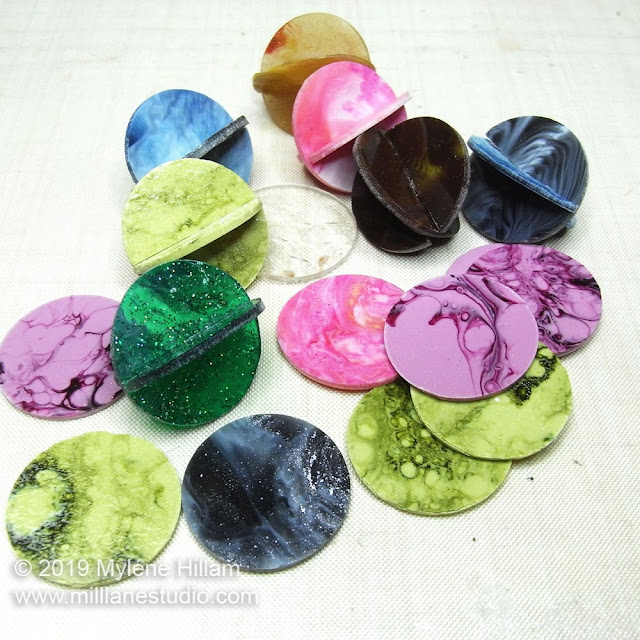 Multi coloured resin orb beads and disks