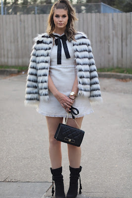 black and white fur coat, white mini dress with black bow