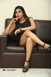 Tollywood Upcoming Actress Pooja Roshan Stills in Black Short Dress at Plus 1 Movie Trailer Launch  0296.JPG