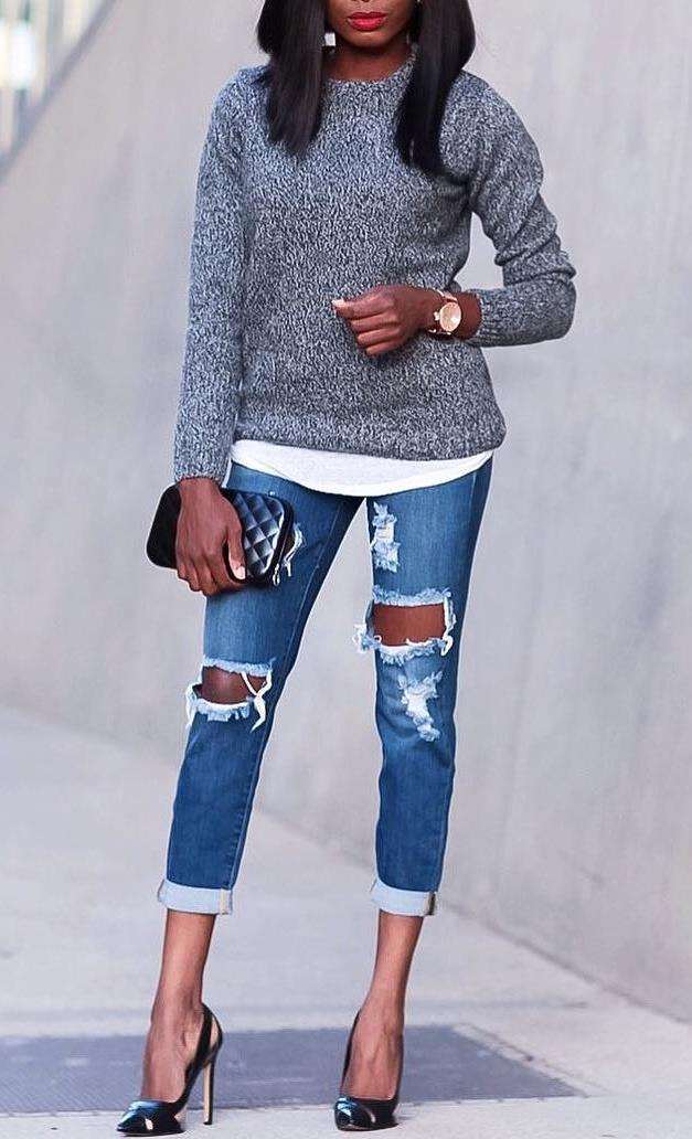 how to style a pair of distressed jeans : grey sweater + white top + clutch + heels