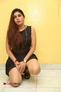 Tollywood Upcoming Actress Pooja Roshan Stills in Black Short Dress at Plus 1 Movie Trailer Launch  0249.JPG