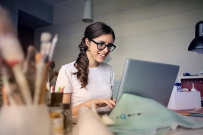 woman using laptop for business