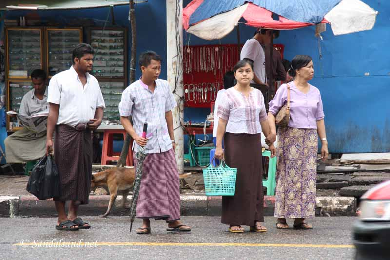 Men wear longyi in Myanmar
