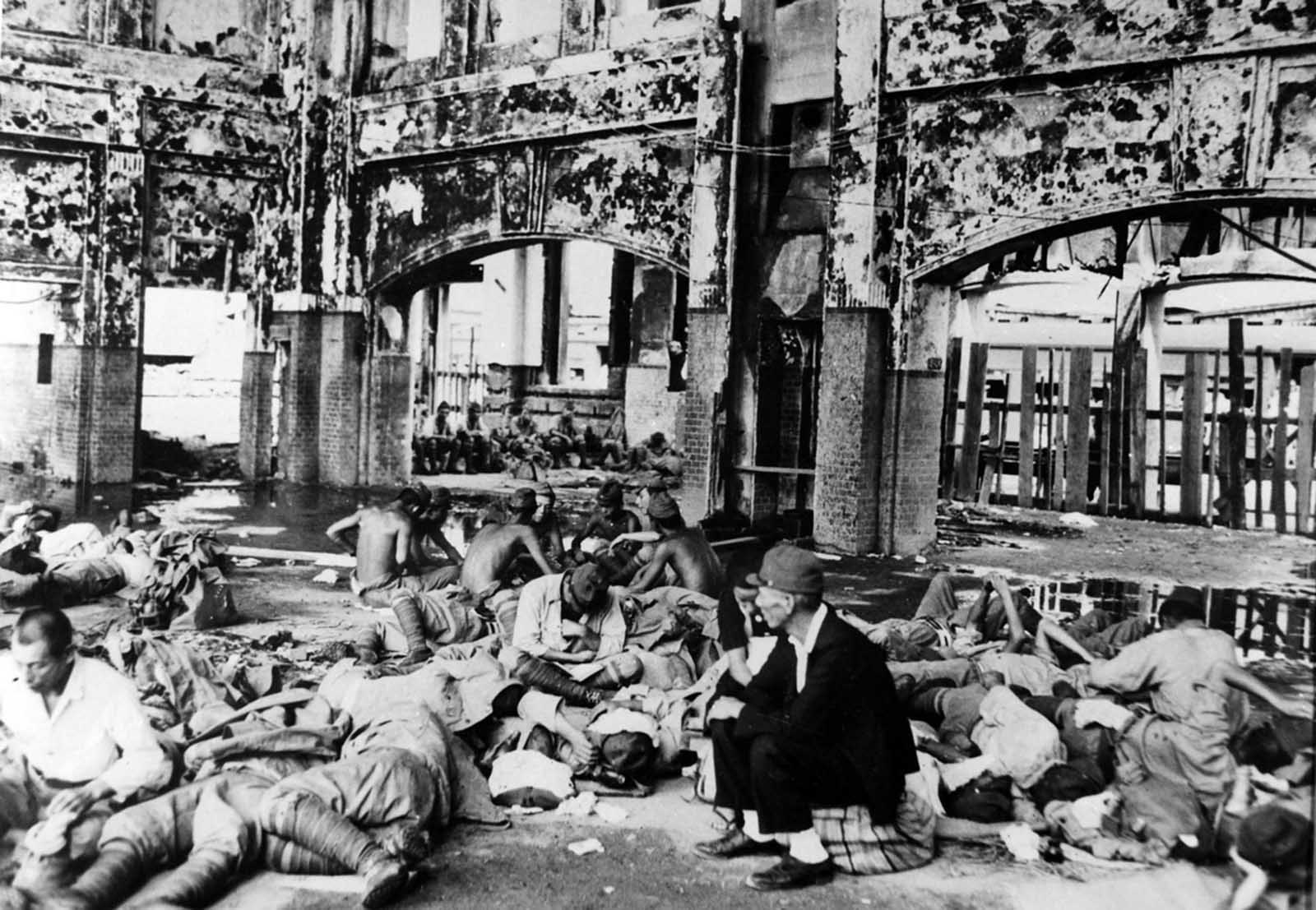 Japanese troops rest in the Hiroshima railway station after the atomic bomb explosion.