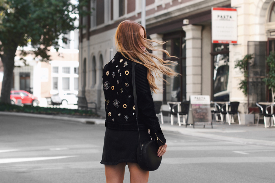 Black suede jacket, embellished jacket, round cross body bag, street style