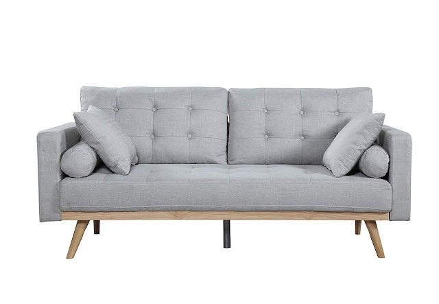 light gray sofa with cushions