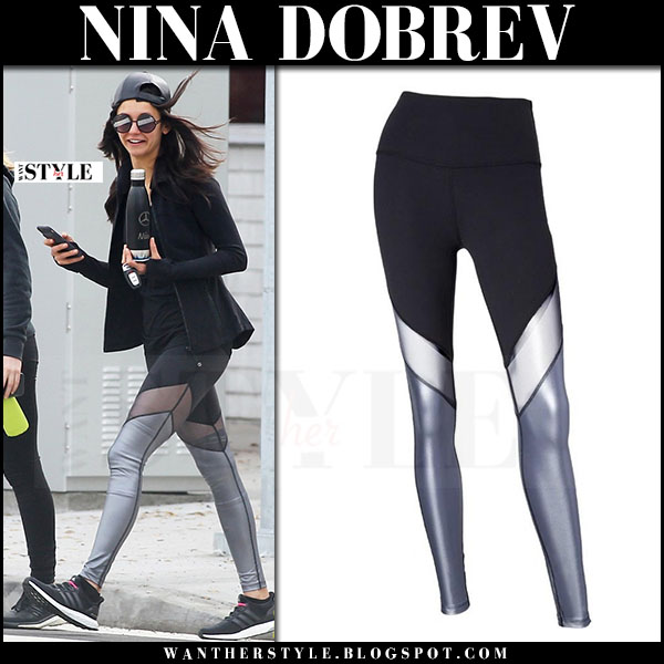 Nina Dobrev in grey paneled leggings beyond yoga, black sneakers and black jacket what she wore