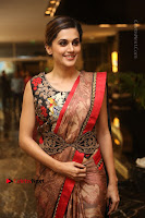 Tapsee Pannu Latest Stills in Red Silk Saree at Anando hma Pre Release Event .COM 0065.JPG