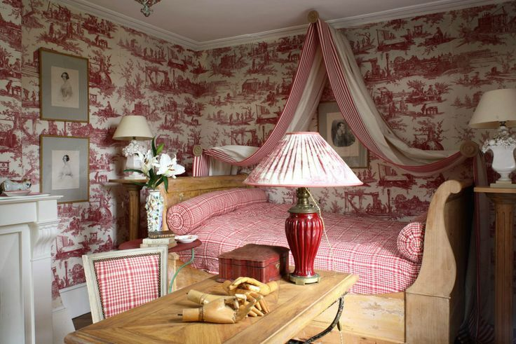 The Classic Styling Of Red Toile Pillows And Canopy Curtains Featuring  Beautiful Birds Brings An Aristocratic French Feel To This Bedroom.