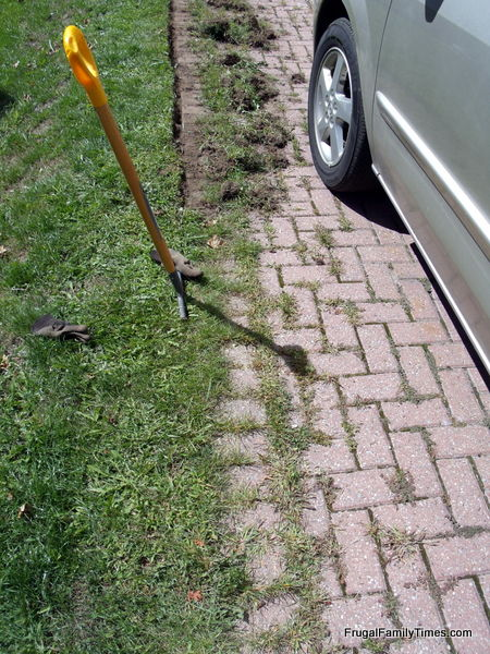 first step to getting rid of weeds in patio or driveway edger edging tool