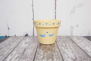 Whether you use this pretty pot to hold a beautiful gardening gift or your favourite plant, it will be loved. Decorated using DecoArt Chalky Finish and bluebirds from You Can Folk It's Series 1 painting kits.