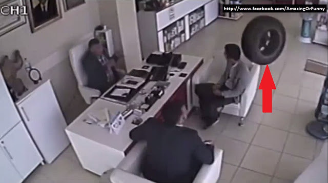 runaway tire, runaway tyre, runaway, tyre, tire, turkey, turkish, pharmacy, meeting, adana, southern turkey, abdulkadir erdeve, door, cctv, video, viral,