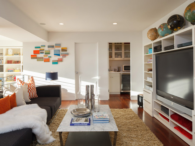 Picture of small sitting area and large tv on the gallery in the bedroom