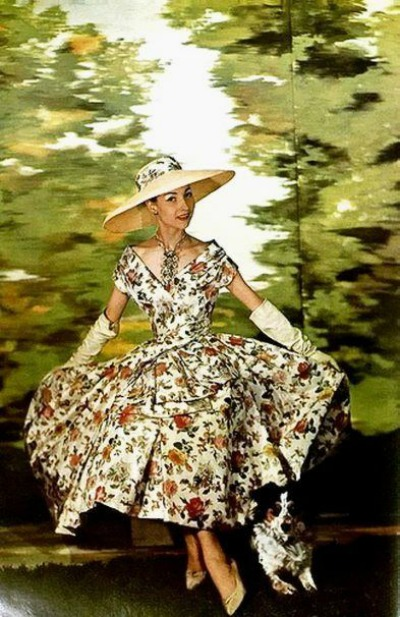 Model Posed in Flower Print Dress with background of trees for L' Art et la Mode, 1956
