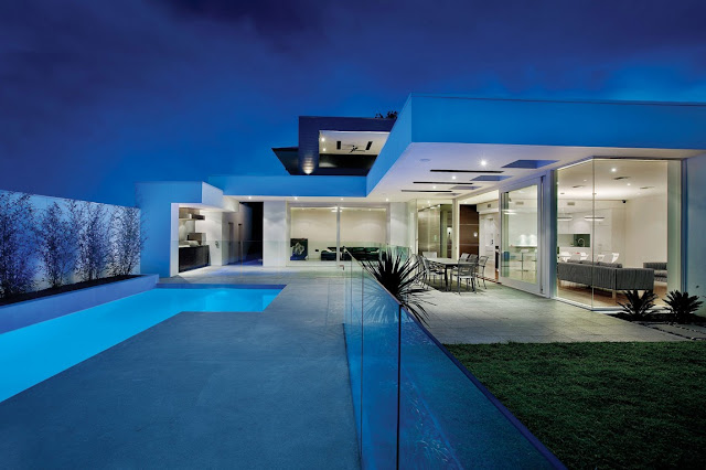 Modern home from the terrace at night