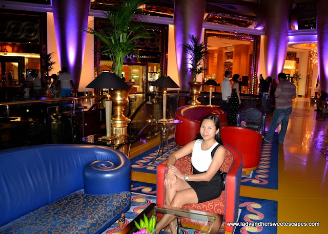 Lady at Burj al Arab upper lobby