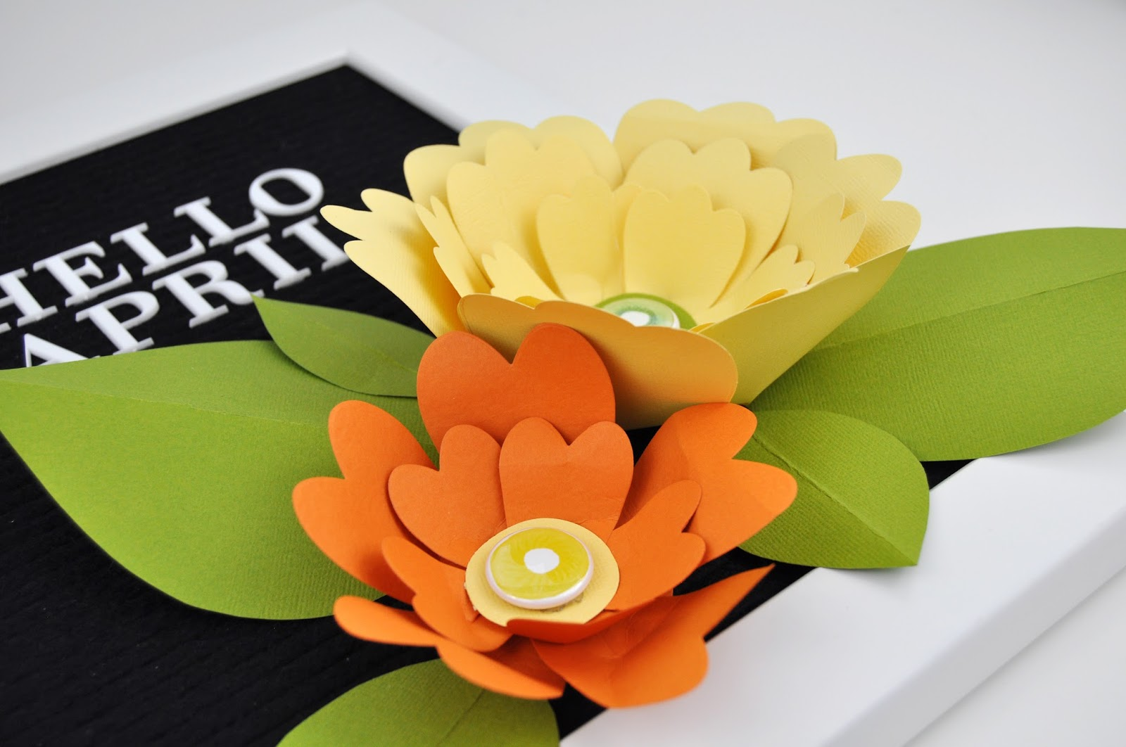 Letterboard Paper Flowers tutorial by Jen Gallacher from www.jengallacher.com for A Flair for Badges. How to create paper flowers for a letterboard. How to die cut and layer paper flowers.