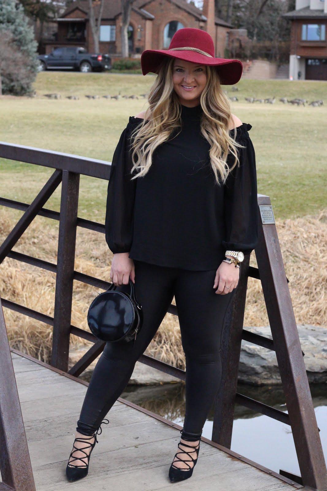 Black cold shoulder top by popular Colorado fashion blogger Delayna Denaye
