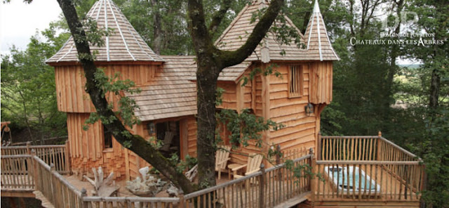 قائمة منزل بناؤهم الأشجار بصورة