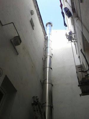 foto salida de humos cocina por patio madrid