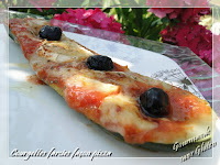 http://gourmandesansgluten.blogspot.fr/2015/07/courgettes-farcies-facon-pizza_18.html