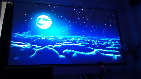 "100"" Projection screen with YouTube video floating over clouds."