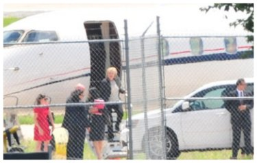 Hillary Clinton getting off a private jet.