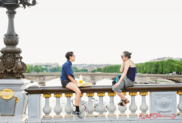 Two women talking while straddling the rail of Pont Alexandre III. If you're going to the Cité.. Shots from Paris on June 26 2017 for Street Fashion Sydney.