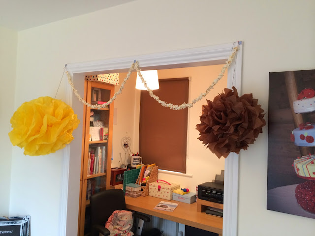 tissue pompoms and popcorn garland