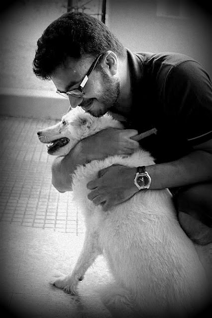 This is one of my favourite pics with my pet dog, Tripsy. Tripsy is unlike other canines. She doesn't eat fried food, is very selective about whom she'll bark at and depending on her mood be loving or aloof. Inspite of us giving her a warm place to sleep she chooses to rest having our car as the roof over her head. And yes, she doesn't like any visitors.   Clicked on a Lumia 920