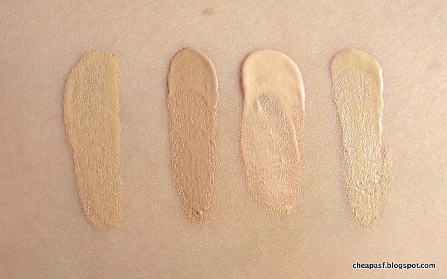 Swatches of Giorgio Armani Luminous Silk Foundation in shade 2, Boot No7 Lift & Luminate Foundation in Cool Vanilla, TheBalm Time Balm Tinted Moisturizer in Lighter than Light, and Maybelline Superstay Better Skin Foundation in Porcelain.