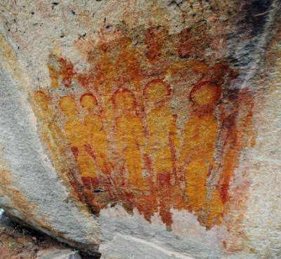 Ancient cave art depicting Aliens and a UFO in India discovered by chance.