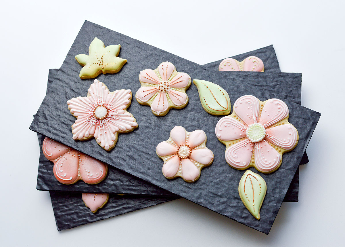 Cushion padding layers with decorated stylised flower cookies, photo by Honeycat Cookies