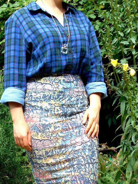 Blue check shirt, graffiti pencil skirt and perfume bottle necklace