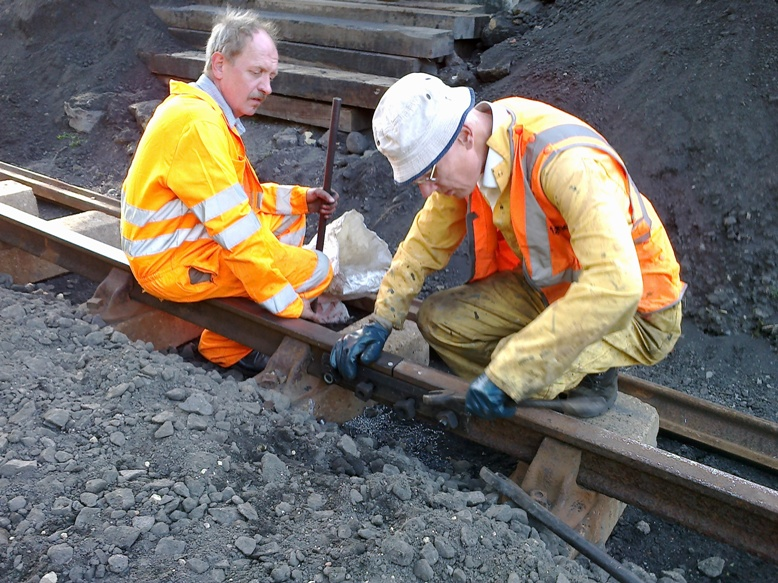 David, a passing volunteer from Huddersfield, assists Rob with drilling and fishplating