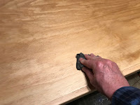 Sanding between coats with fine steel wool