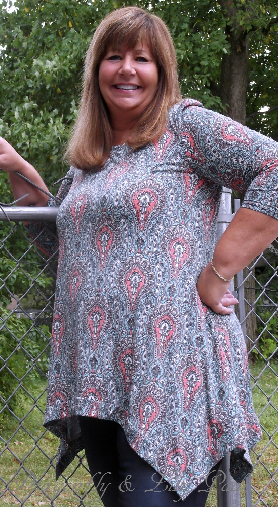 Close up of Pretty Corral top, Blue print, 3/4 length sleeves, Jeans that feel so comfortable.