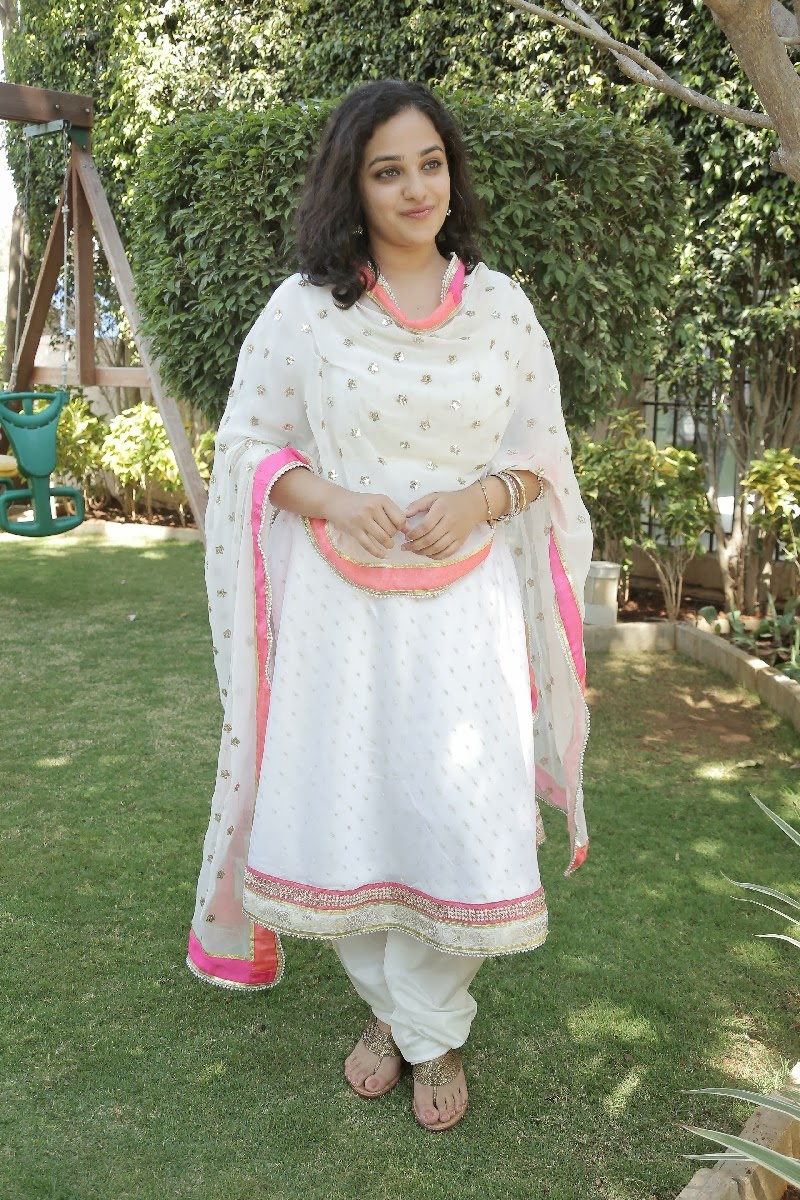 Nithya Menon Smiling Photos In White Churidar